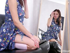 Modest teen Odell is toying her unruffled beautiful pussy in front of the mirror