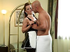 The maid at the hotel cleans his room then rides his cock