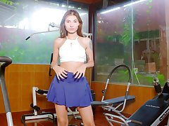 Naughty babe Nataly Leon is stimulating clit in a difficulty gym