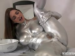 Unfurnished belle covers herself in metamorphose paint of a kinky solo