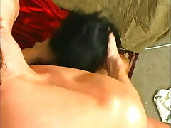 Ebony chick with small tits gives white dude some head